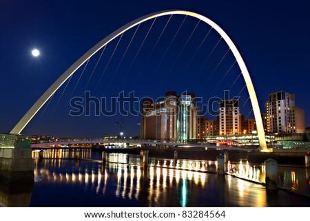 Moon Over Millennium Bridge - stock photo