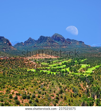 Moon over mountains mountains surrounding Sedona Arizona - stock photo