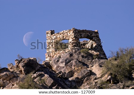 Moon over old building - stock photo