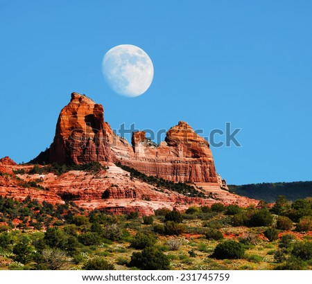 Moon over Red Rock country mountains surrounding Sedona Arizona