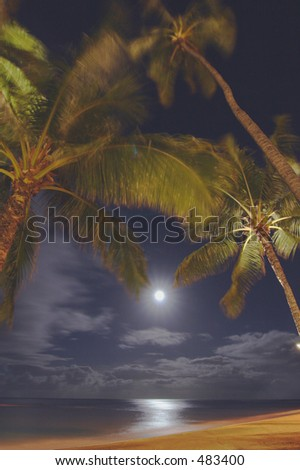 Moon over Waikiki beach, Oahu - stock photo
