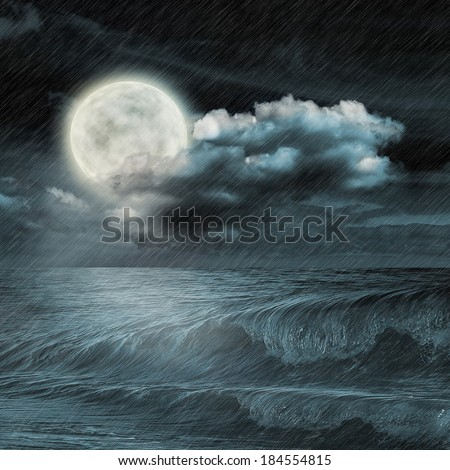 moon reflected in water wavy surface - stock photo