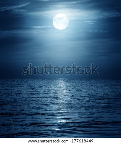 moon reflecting in a sea - stock photo