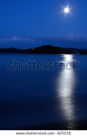 Moon reflection at an island near new zealand - stock photo