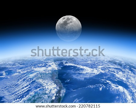 Moon rising behind the Earth's atmosphere. Small stars are in the background. Elements of this image furnished by NASA.