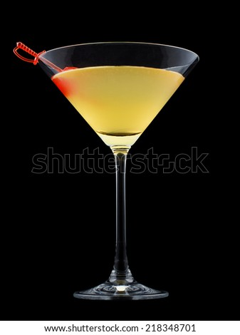 Moon River is a cocktail that contains gin, apricot brandy, Cointreau, Galliano, fresh lemon juice and is garnished with a maraschino cherry - stock photo