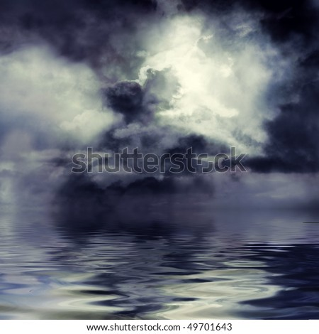 Moon shining through dark clouds over water, atmospheric background - stock photo