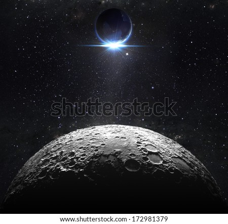 moon surface with view sunrise of the earth  - stock photo