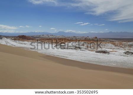 Moon Valley or Valle de la Luna Landscape with volcanoes in Atacama Desert, Chile, South America - stock photo
