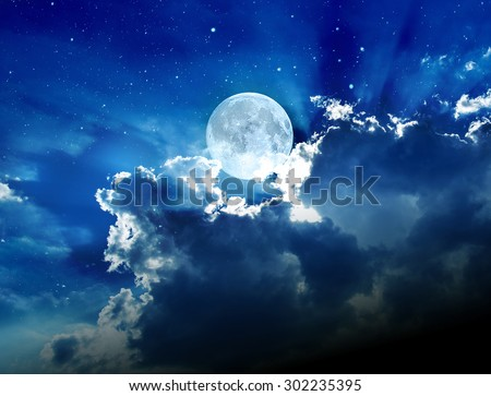 Moon with clouds and stars