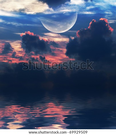moon with  clouds over the water - stock photo