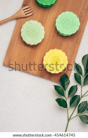 Mooncake and tea, Chinese mid autumn festival food. Angle view from above - stock photo