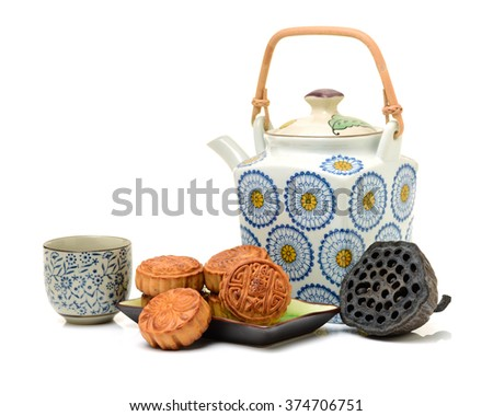 Mooncake and tea,Chinese mid autumn festival food on white background - stock photo