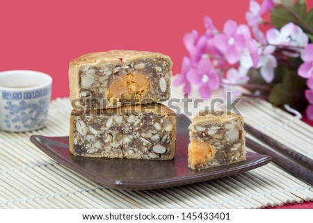 mooncake slice ,inside with yolk ,nuts,almond and cream - stock photo