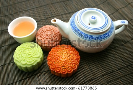 mooncakes with a tea pot and tea cup - stock photo