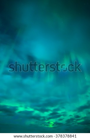 Moonlight landscape with northern lights  (Aurora borealis) - stock photo