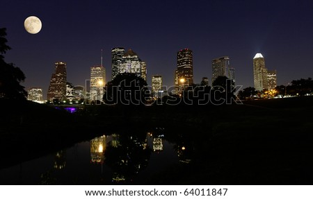 Moonlight over Houston Skyline reflecting in the Buffalo Bayou - stock photo