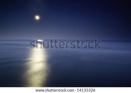 moonlighting in the sea, long eposure o capture the beauty of this nightscene - stock photo