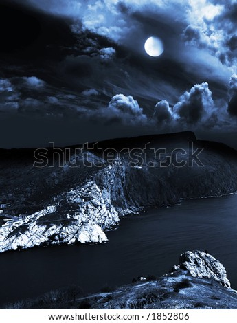 moonlit night and clouds on night sky in the sea - stock photo