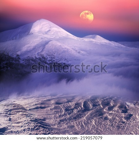 Moonrise among alpine peaks, unforgettable beauty of the spectacle, worth dangerous night-climbing in winter. Goverla-highest point of Ukraine - stock photo
