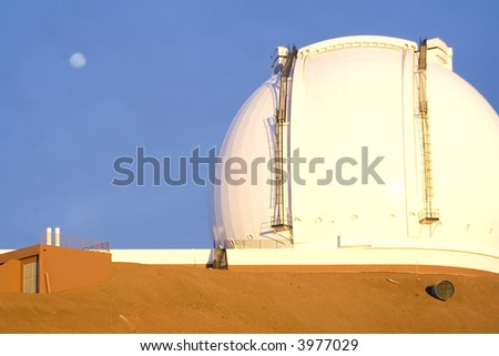 Moonrise and sunset at Keck Observatory atop Mauna Kea on the Big Island of Hawaii, USA - stock photo