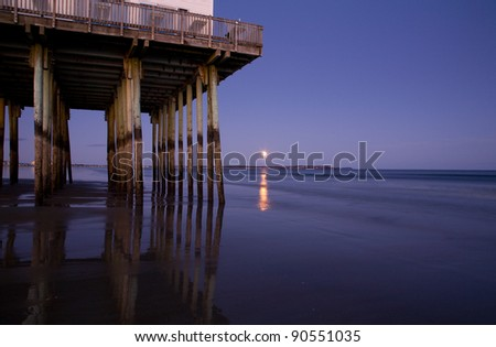 Moonrise at Old Orchard Beach Pier - stock photo