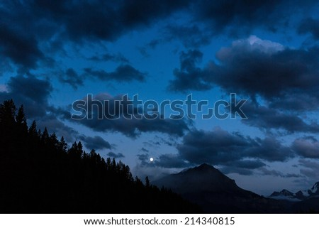 Moonrise at the Rocky mountains in the banff national park canada  - stock photo