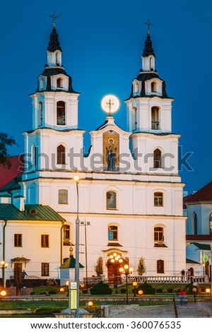 Moonrise of Full Moon over Cathedral Of Holy Spirit In Minsk. Famous and Main Orthodox Church Of Belarus in Minsk - stock photo