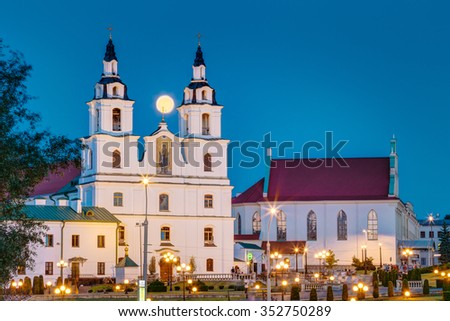 Moonrise over Cathedral Of Holy Spirit In Minsk. Famous and Main Orthodox Church Of Belarus in Minsk - stock photo