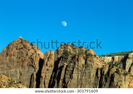 Moonrise over rocky bluffs in Kolob Canyons section of Zion National Park - stock photo