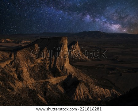 Moonrise over the desert of Bardenas Reales, Navarra, Spain - stock photo
