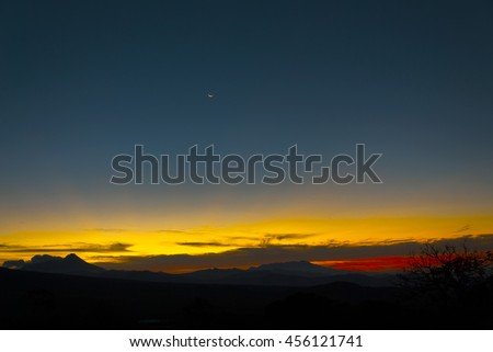 Moonrise over the rugged mountains and volcano in Guatemala - stock photo