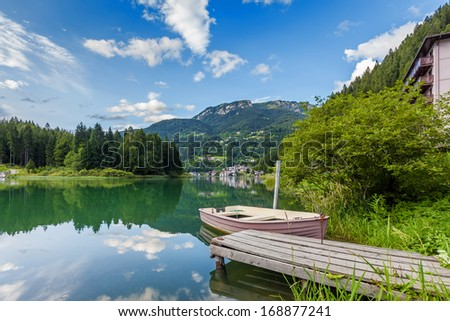Moored boat on mountain lake - stock photo