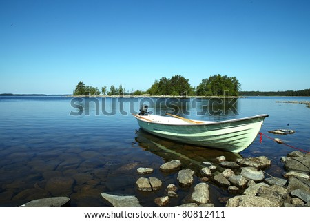 Moored boat on the calm lake - stock photo