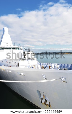 Moored white naval ship with gun. - stock photo