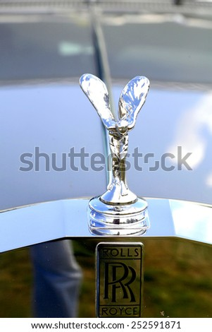 Moorgreen, Nottinghamshire, UK. AUGUST 26, 2013.  The Rolls Royce emblem and spirit of ecstacy mascot on the front of a Silver Shadow II  at Moorgreen country show. - stock photo