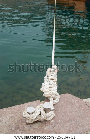 Mooring and knight with rope - stock photo