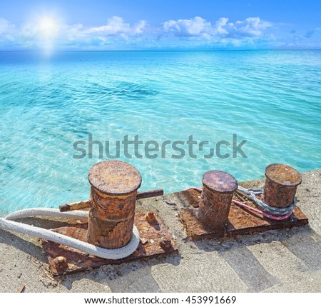 Mooring bollards with ship ropes. - stock photo