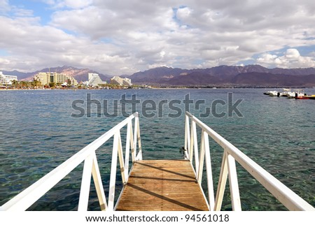 Mooring for boats and general view to Eilat city and Jordan mountains (Red sea. Israel) - stock photo