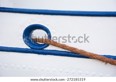 Mooring rope on a greek style sailing vessel. - stock photo