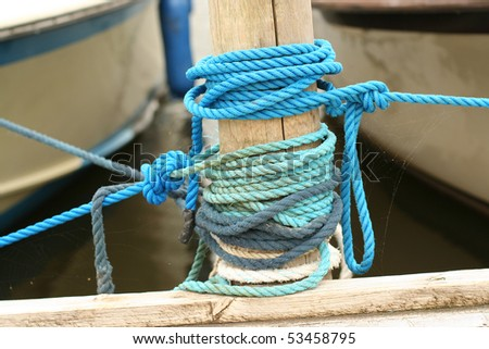Mooring ropes detail - stock photo