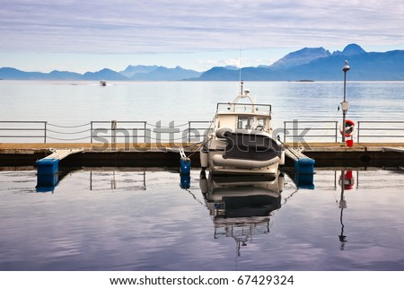 mooring with boats on tranquil sea gulf - stock photo