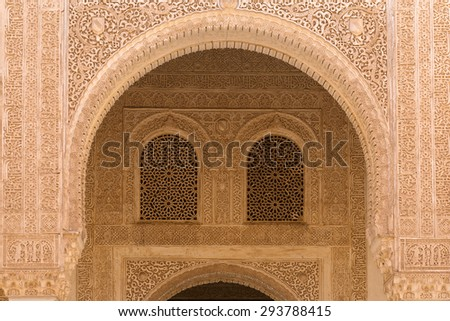 Moorish arch in famous Alhambra Nazaries palace, Granada, Spain
