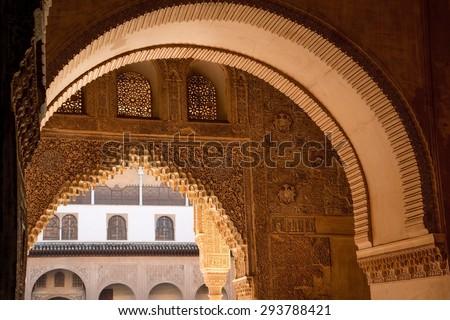 Moorish arch in famous Alhambra Nazaries palace, Granada, Spain - stock photo