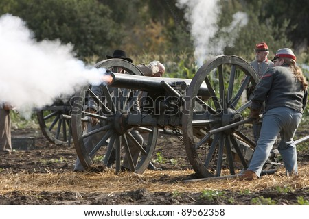 """MOORPARK, CA - NOV 13: Richmond Howitzers fire cannons in """"The Blue & The Gray"""" event Nov 13, 2011 Moorpark, CA. The largest Civil War reenactment in the West. - stock photo"""