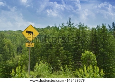 Moose Crossing Road Sign in Ontario, Canada.  - stock photo