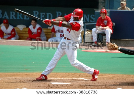 MOOSIC, PA - APRIL 27: Scranton/Wilkes-Barre Red Baron Ryan Howard swings at a pitch in the April 27, 2005 game in Moosic, PA. Howard hit .371 for the Barons in 2005. - stock photo