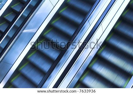 Mooving escalators and stairs - stock photo