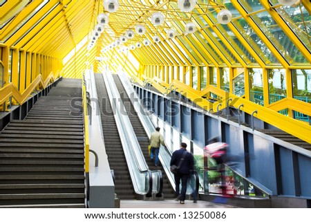 Mooving escalators and stairs, bridge with spheres