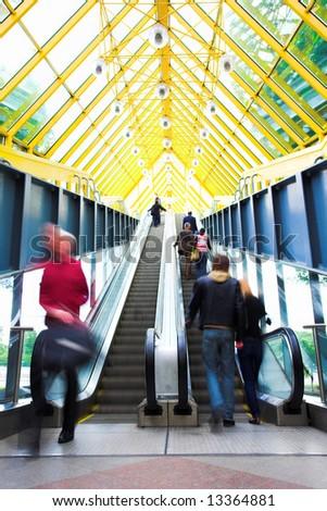 Mooving escalators and stairs, bridge with spheres - stock photo